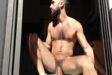 Bearded man Massages his nuts