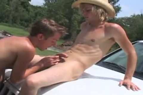 Country males washing car start to pound